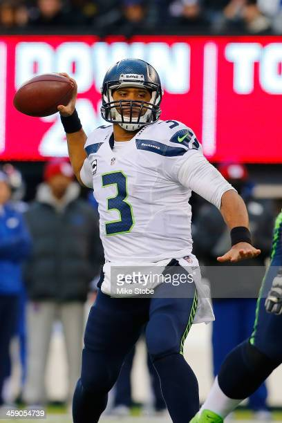 Russell Wilson of the Seattle Seahawks in action against the New York Giants at MetLife Stadium on December 15 2013 in East Rutherford New Jersey The...