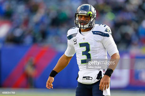 Russell Wilson of the Seattle Seahawks in action against the New York Giants at MetLife Stadium on December 15, 2013 in East Rutherford, New Jersey....