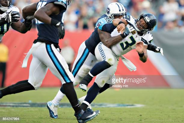 Russell Wilson of the Seattle Seahawks is hit after throwing a pass by Jurrell Casey of the Tennessee Titans at Nissan Stadium on September 24, 2017...