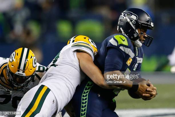 Russell Wilson of the Seattle Seahawks is sacked by Kyler Fackrell of the Green Bay Packers in the third quarter at CenturyLink Field on November 15...