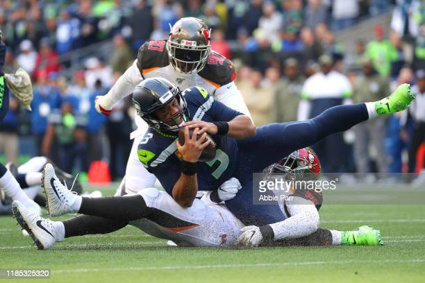 Russell Wilson of the Seattle Seahawks is sacked by Lavonte David of the Tampa Bay Buccaneers in the third quarter at CenturyLink Field on November...