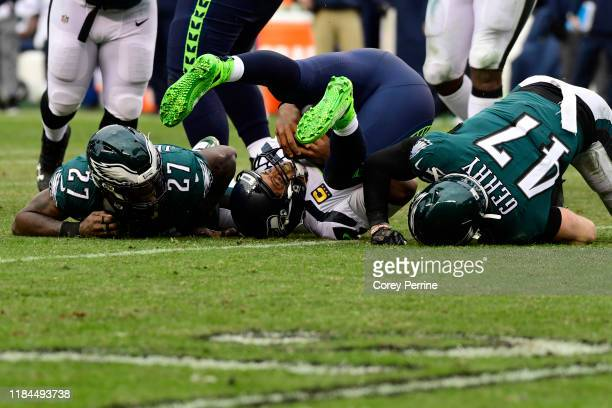 Russell Wilson of the Seattle Seahawks is sacked by Malcolm Jenkins of the Philadelphia Eagles and Nate Gerry during the fourth quarter at Lincoln...