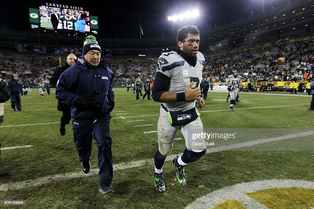 Russell Wilson #3 of the Seattle Seahawks jogs off the field after the Green Bay Packers beat the Seattle Seahawks 38-10 at Lambeau Field on December 11, 2016 in Green Bay, Wisconsin.