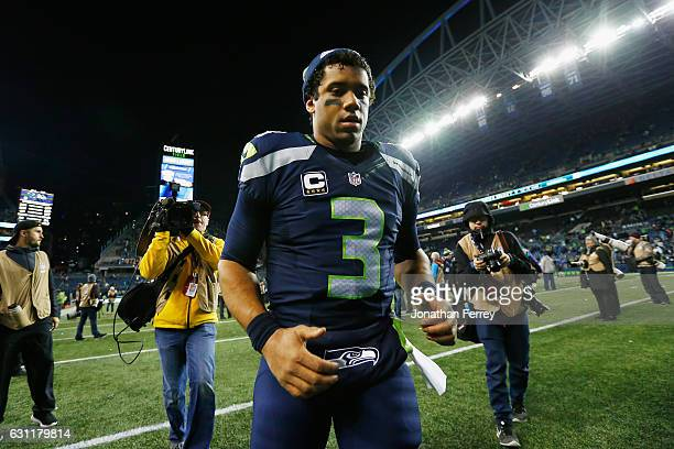 Russell Wilson of the Seattle Seahawks leaves the field after defeating the Detroit Lions 26-6 in the NFC Wild Card game at CenturyLink Field on...