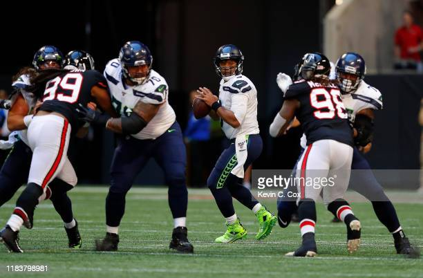 Russell Wilson of the Seattle Seahawks looks to pass against the Atlanta Falcons in the first half at MercedesBenz Stadium on October 27 2019 in...