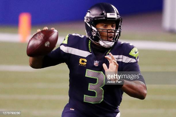 Russell Wilson of the Seattle Seahawks looks to pass during the second half against the New England Patriots at CenturyLink Field on September 20,...