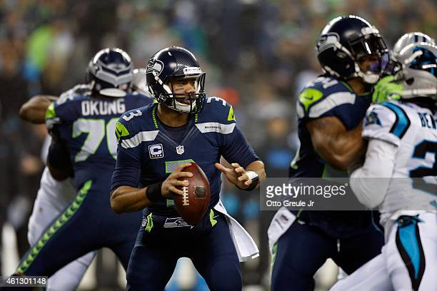 Russell Wilson of the Seattle Seahawks looks to throw a pass in the first quarter against the Carolina Panthers during the 2015 NFC Divisional...
