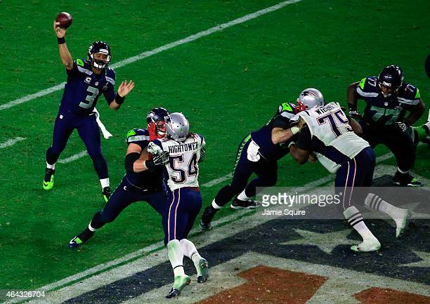 Russell Wilson of the Seattle Seahawks makes a pass in the second half against the New England Patriots during Super Bowl XLIX at University of...