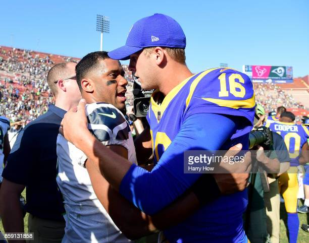 Russell Wilson of the Seattle Seahawks meets Jared Goff of the Los Angeles Rams after a 16-10 Seahawks win at Los Angeles Memorial Coliseum on...
