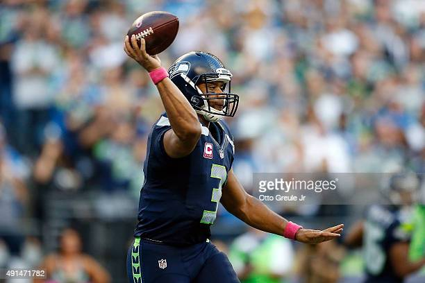 Russell Wilson of the Seattle Seahawks passes the ball during the first half against the Detroit Lions at CenturyLink Field on October 5 2015 in...
