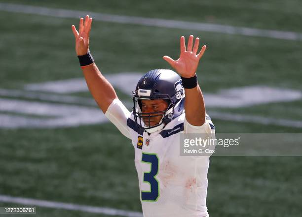 Russell Wilson of the Seattle Seahawks reacts after a rushing touchdown in the fourth quarter against the Atlanta Falcons at Mercedes-Benz Stadium on...