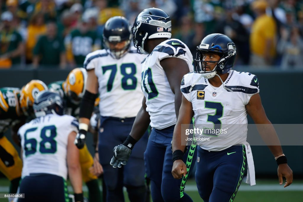 Russell Wilson #3 of the Seattle Seahawks reacts during the second half against the Green Bay Packers at Lambeau Field on September 10, 2017 in Green Bay, Wisconsin.
