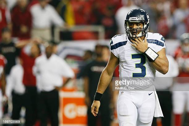 Russell Wilson of the Seattle Seahawks reacts during their NFC Divisional Playoff Game against the Atlanta Falcons at Georgia Dome on January 13 2013...