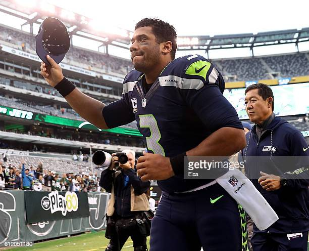 Russell Wilson of the Seattle Seahawks runs off the field after the game against the New York Jets at MetLife Stadium on October 2 2016 in East...
