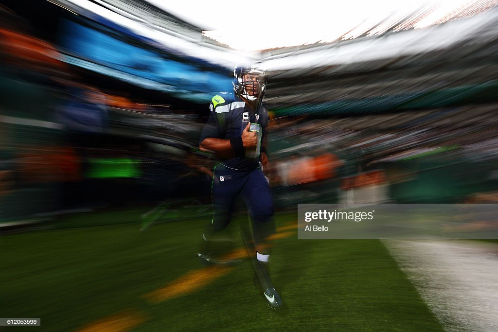 Russell Wilson #3 of the Seattle Seahawks runs onto the field before the game against the New York Jets at MetLife Stadium on October 2, 2016 in East Rutherford, New Jersey.