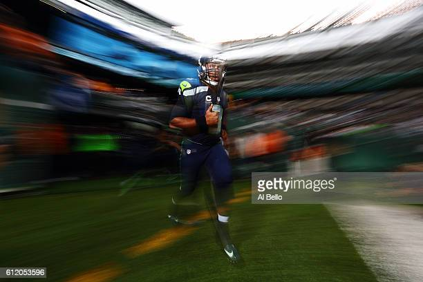 Russell Wilson of the Seattle Seahawks runs onto the field before the game against the New York Jets at MetLife Stadium on October 2 2016 in East...