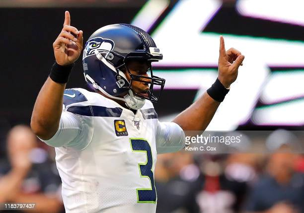 Russell Wilson of the Seattle Seahawks runs the offense in the first half against the Atlanta Falcons at MercedesBenz Stadium on October 27 2019 in...