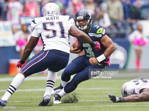 Russell Wilson of the Seattle Seahawks rushes the ball against Jerod Mayo of the New England Patriots during a game at CenturyLink Field on October...