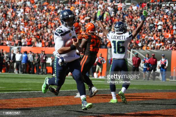 Russell Wilson of the Seattle Seahawks scores a first quarter touchdown against the Cleveland Browns at FirstEnergy Stadium on October 13 2019 in...