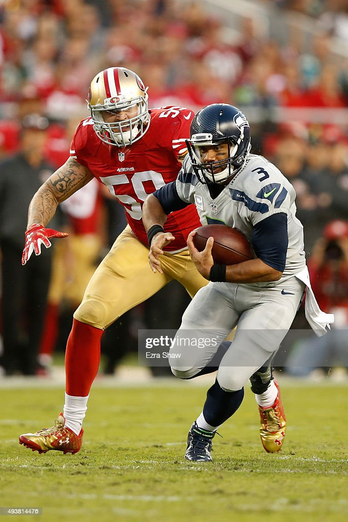 Russell Wilson #3 of the Seattle Seahawks scrambles with the ball against the San Francisco 49ers during their NFL game at Levi's Stadium on October 22, 2015 in Santa Clara, California.