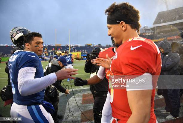 Russell Wilson of the Seattle Seahawks shake hands with Patrick Mahomes of the Kansas City Chiefs after the 2019 NFL Pro Bowl at Camping World...
