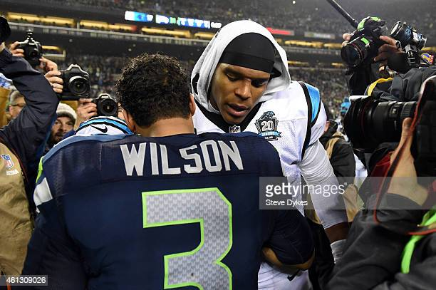 Russell Wilson of the Seattle Seahawks shakes hands with Cam Newton of the Carolina Panthers after their 2015 NFC Divisional Playoff game at...