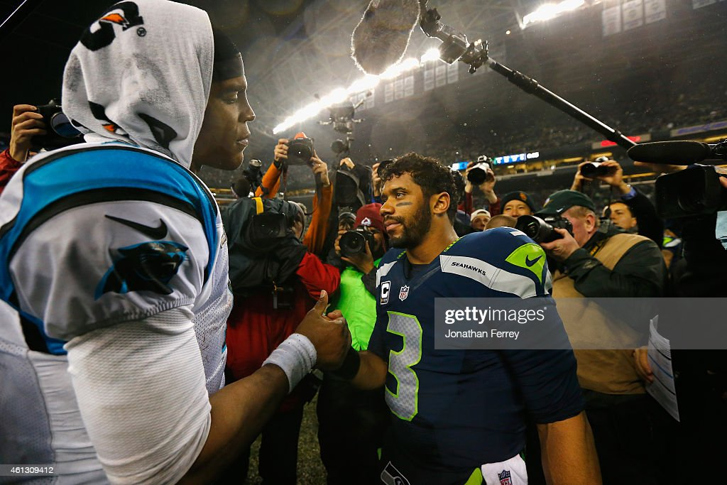 Russell Wilson #3 of the Seattle Seahawks shakes hands with Cam Newton #1 of the Carolina Panthers after their 2015 NFC Divisional Playoff game at CenturyLink Field on January 10, 2015 in Seattle, Washington. The Seattle Seahawks defeated the Carolina Panthers 31 to 17.