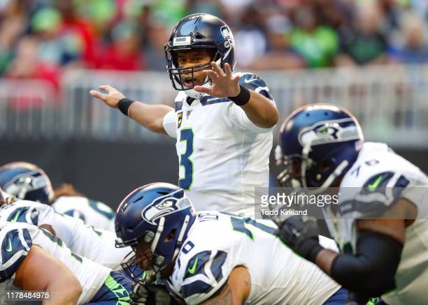 Russell Wilson of the Seattle Seahawks signals at the line in the second half of an NFL game against the Atlanta Falcons at MercedesBenz Stadium on...