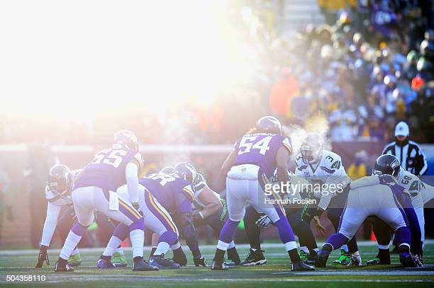 Russell Wilson of the Seattle Seahawks stands under center in the fourth quarter against the Minnesota Vikings during the NFC Wild Card Playoff game...