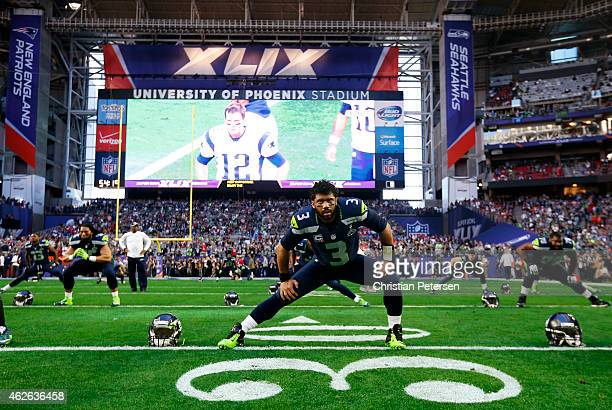 Russell Wilson of the Seattle Seahawks stretches on the field prior to playing in Super Bowl XLIX at University of Phoenix Stadium on February 1 2015...