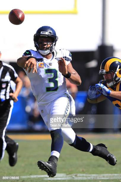 Russell Wilson of the Seattle Seahawks throws a pass during the game against the Los Angeles Rams at the Los Angeles Memorial Coliseum on October 8...