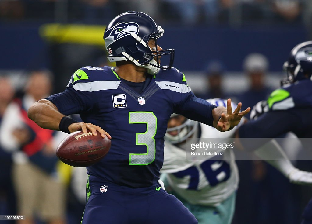 Russell Wilson #3 of the Seattle Seahawks throws against the Dallas Cowboys at AT&T Stadium on November 1, 2015 in Arlington, Texas.