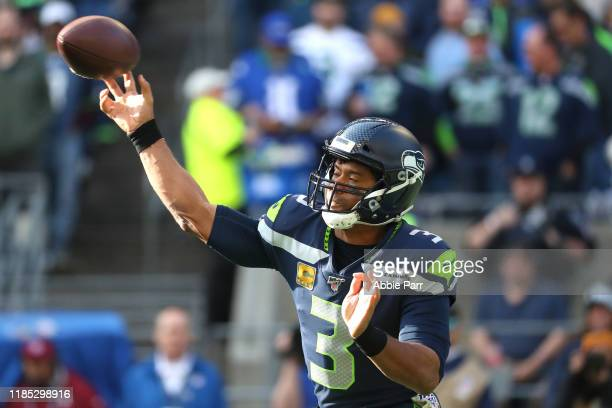 Russell Wilson of the Seattle Seahawks throws the ball in the first quarter against the Tampa Bay Buccaneers during their game at CenturyLink Field...