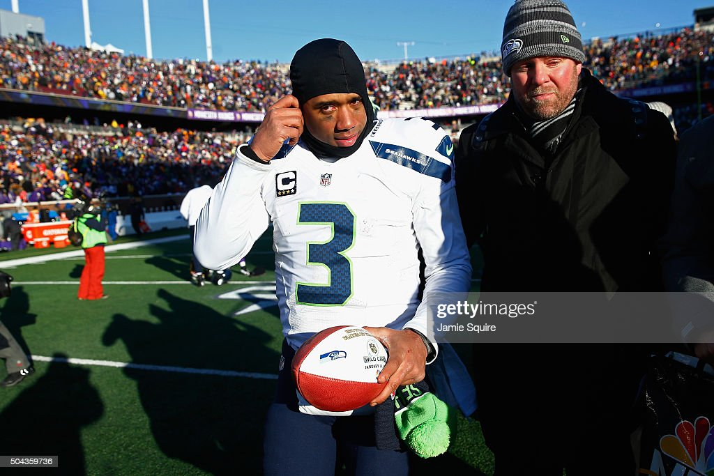 Russell Wilson #3 of the Seattle Seahawks walks off the field after defeating the Minnesota Vikings with a score of 10 to 9 during the NFC Wild Card Playoff game at TCFBank Stadium on January 10, 2016 in Minneapolis, Minnesota.