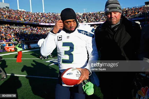 Russell Wilson of the Seattle Seahawks walks off the field after defeating the Minnesota Vikings with a score of 10 to 9 during the NFC Wild Card...