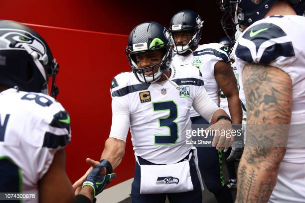 Russell Wilson of the Seattle Seahawks walks out of the tunnel prior to their NFL game against the San Francisco 49ers at Levi's Stadium on December...