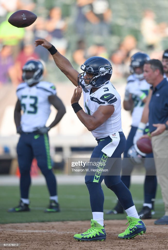 Russell Wilson #3 of the Seattle Seahawks warms up during pregame warm ups prior to the start of their game against the Oakland Raiders at the Oakland-Alameda County Coliseum on August 31, 2017 in Oakland, California.
