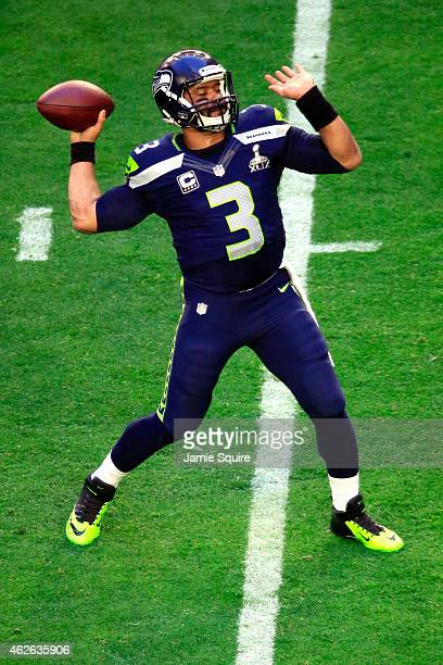 Russell Wilson of the Seattle Seahawks warms up prior to Super Bowl against the New England Patriots XLIX at University of Phoenix Stadium on...