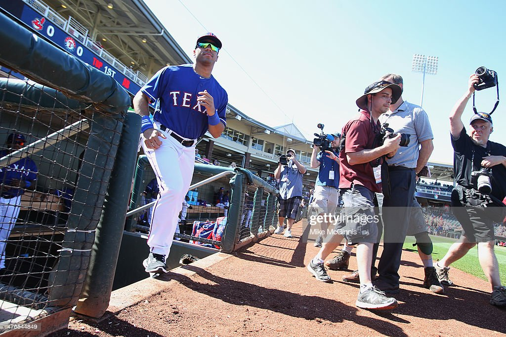 Russell Wilson #3 of the Texas Rangers runs onto the field to sign autographs before the start of the game against the Cleveland Indians at Surprise Stadium on March 03, 2014 in Surprise, Arizona.