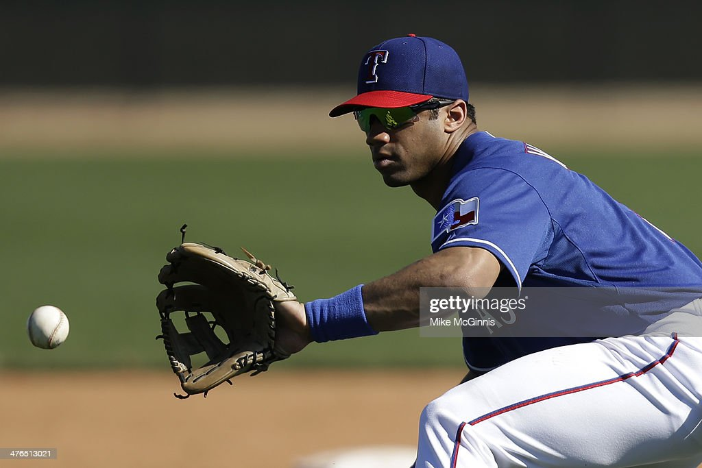 Russell Wilson #3 of the Texas Rangers runs through some infield drills during a work out before the game against the Cleveland Indians at Surprise Stadium on March 03, 2014 in Surprise, Arizona.