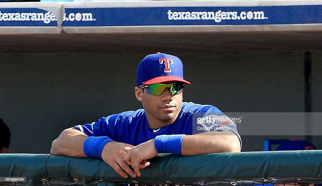 Russell Wilson #3 of the Texas Rangers watches actionon the field during a spring training baseball game against the Cleveland Indians on March 3, 2014 in Surprise, Arizona.