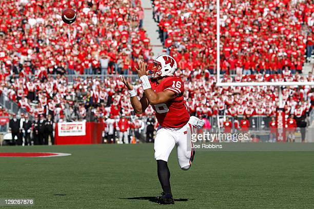Russell Wilson of the Wisconsin Badgers catches a 25yard touchdown pass on a trick play in the second quarter against the Indiana Hoosiers at Camp...