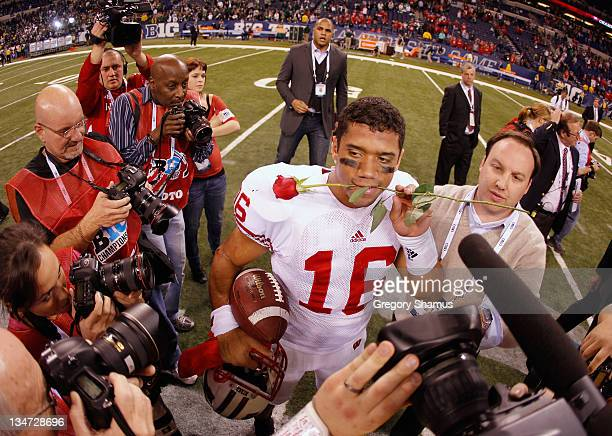 Russell Wilson of the Wisconsin Badgers celebrates after they won 42-39 against the Michigan State Spartans during the Big 10 Conference Championship...