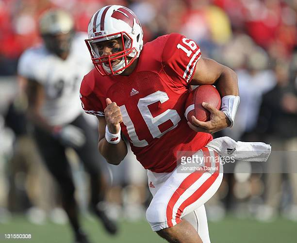Russell Wilson of the Wisconsin Badgers runs 6 yards for a touchdown against the Purdue Boilermakers at Camp Randall Stadium on November 5, 2011 in...