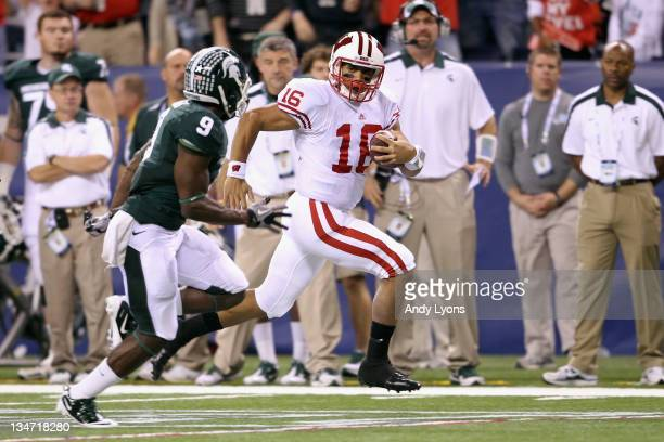 Russell Wilson of the Wisconsin Badgers runs for yards after the catch on a halfback option play in the first quarter against Isaiah Lewis of the...