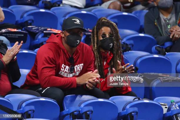 Russell Wilson, quarterback for the Seattle Seahawks, watches the game between the Stanford Cardinal and the Louisville Cardinals in the Elite Eight...