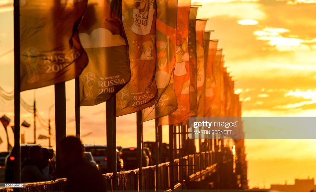 Russia 2018 flags flutter on a bridge near the stadium in the city