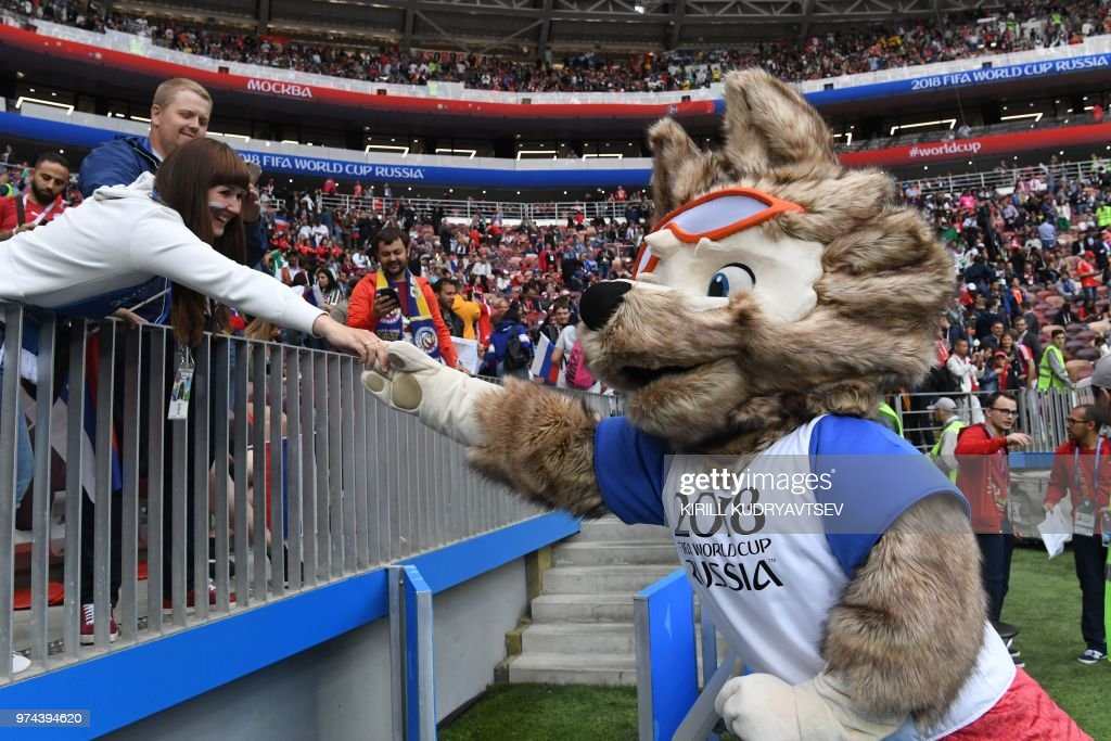 Russia 2018 World Cup football tournament's official mascot Zabivaka greets fans during the Russia 2018 World Cup Group A football match between Russia and Saudi Arabia at the Luzhniki Stadium in Moscow on June 14, 2018. (Photo by Kirill KUDRYAVTSEV / AFP) / RESTRICTED