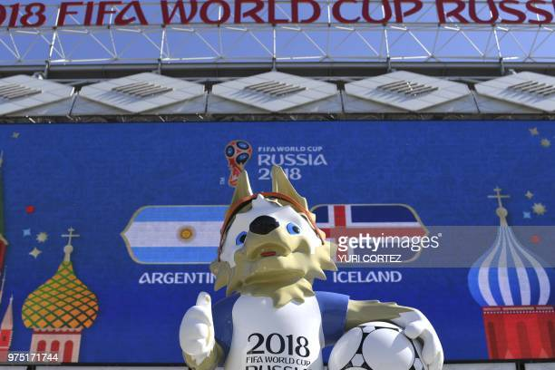 Russia 2018 World Cup mascot Zabivaka poses for a picture in front of Spartak Stadium in Moscow on June 14 a day before the match between Argentina...