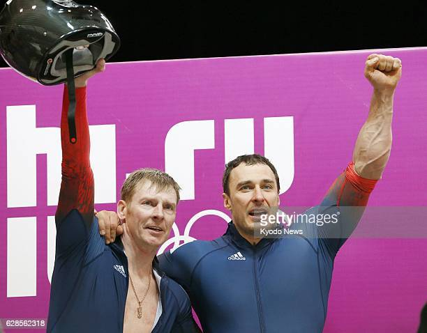 SOCHI Russia Alexander Zubkov and Alexey Voevoda of Russia celebrate after winning the gold medal in the men's twoman bobsleigh at the Sochi Winter...